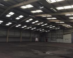 131 ft x 100 ft x 23 ft - (40m x 30.5m x 7m) Used Steel Building