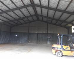 60 ft x 54 ft x 18 ft - (18.3m x 16.5m x 5.5m) Used Steel Building